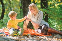 Explore nature together. Mom and kid boy relaxing while hiking in forest. Family picnic. Mother pretty woman and little stock photos