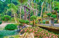 Interesting landscaping, Mae Fah Luang garden, Doi Tung, Thailand. Explore new ideas for garden landscaping in Mae Fah Luang garden, decorated with hanging royalty free stock photos