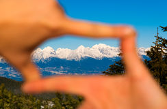 Explore Tatras mountains in Slovakia. High Tatras mountains framed by hands, concept of nature in focus Stock Image