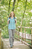 Explore - Woman Hiking in a Forest Stock Image