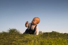 Explore the world. Baby is having outdoor fun and exploring the world around. There are nice afternoon lights Royalty Free Stock Photos