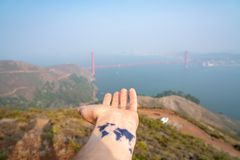 Young man with a tattoo of the world on his hand. Beautiful world. Explore the world in California. Young man with a tattoo of the world on his hand. Beautiful stock photos