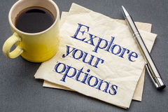 Explore your options on napkin. Explore your options advice - handwriting on a napkin with a cup of coffee royalty free stock images