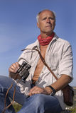 Explorer. Posing outdoors with is binoculars looking for adventure Royalty Free Stock Photos