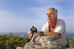 Explorer. With is binoculars looking for adventure Stock Photo