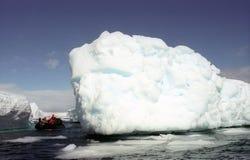 Explorer Antarctica. Group people explore iceberg in Antarctica Stock Images