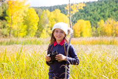 Explorer binocuar kid girl in yellow autumn nature Royalty Free Stock Image