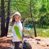 Explorer blond kid girl sith stick and winter white fur Royalty Free Stock Images