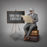 Explorer businessman lost in office and reading map with blackboard Royalty Free Stock Photos