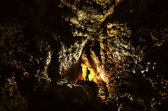 Explorer in cave with light Royalty Free Stock Photo