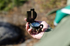 Explorer consulting a classical handheld compass Stock Photography
