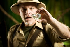 Explorer finding a huge gem in the jungle Stock Photos