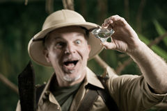Explorer finding a huge gem in the jungle Royalty Free Stock Photography