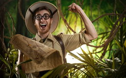 Explorer finding the right path in the jungle Stock Image