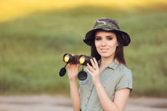 Explorer Girl with Camouflage Hat and Binoculars Stock Photography