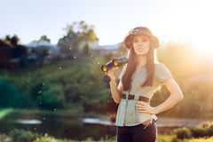 Explorer Girl with Camouflage Hat and Binoculars Royalty Free Stock Photography
