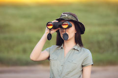 Explorer Girl with Camouflage Hat and Binoculars Royalty Free Stock Images