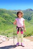 Explorer girl hicker stick high green valley Stock Photos