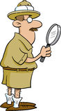 Explorer holding a magnifying glass Royalty Free Stock Image