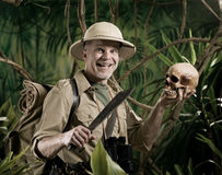 Explorer with human skull stock photography