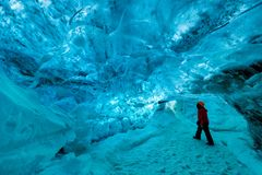 Explorer inside an ice cave, vatnajokull national park, Iceland stock image