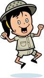 Explorer Jumping. A cartoon girl explorer jumping and smiling Stock Images
