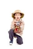 Explorer. Little explorer boy on safari isolated in white Royalty Free Stock Photography