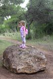 Explorer little girl forest park searching Royalty Free Stock Photo