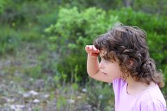 Explorer little girl forest park searching Royalty Free Stock Photos