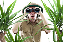 Explorer looking through binoculars Stock Photography