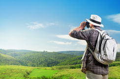 Explorer looking through binoculars outdoors Royalty Free Stock Images