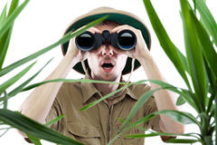 Explorer Looking Through Binoculars Royalty Free Stock Photography