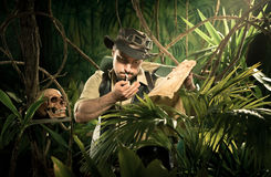 Explorer lost in jungle Royalty Free Stock Image