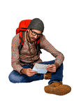 Explorer man browsing map over white background. Royalty Free Stock Photo