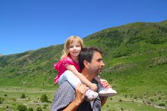 Explorer mountain little girl and father. In green outdoor valley landscape Stock Photos