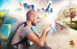Explorer recalls his travels. With his tablet Royalty Free Stock Photography