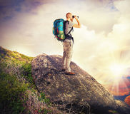 Explorer search. Explorer observes in search of new lands Stock Photography