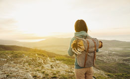 Explorer walking in mountains Stock Photos