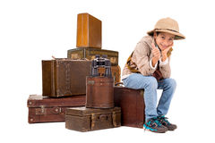 Explorer. Young boy with suitcases playing Safari isolated in white Royalty Free Stock Photo