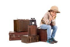 Explorer. Young boy with suitcases playing Safari isolated in white Royalty Free Stock Photography