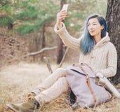 Explorer girl taking selfie outdoor. stock images