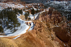 Explorers in Bryce Canyon. Explorers walking down the path in the Bryce Canyon royalty free stock photos