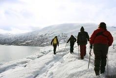 Explorers in a glacier Royalty Free Stock Image
