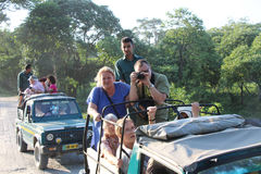 The explorers of the jeep safari at Jaldapara National Park in India. The explorers of the jeep safari at Jaldapara National Park, West Bengal in India stock images