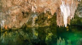 Exploring Aktun Chen caves on Riviera Maya. Beautiful stalactites and stalagmites, underground river at Aktun Chen caves in Yucatan peninsula, Mexico royalty free stock photo