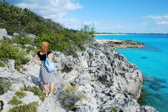 Exploring Bahamas. The girl exploring tropical beauty of Half Moon Cay, The Bahamas Royalty Free Stock Images