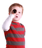 Exploring Boy. A cute little boy pretending to be exploring using a toy telescope, isolated on a white background Stock Image