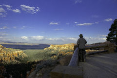 Exploring Bryce Canyon. Tourist enjoying the view in Bryce Canyon Royalty Free Stock Images