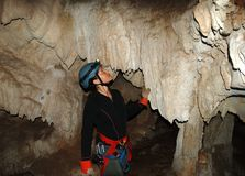 Exploring Caves. The girl exploring Lost Mayan Caves in Belize Stock Photo