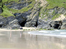 Exploring caves on Portreath beach. Stock Photo